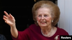 Former British Prime Minister Margaret Thatcher waves from her front doorstep. (File)