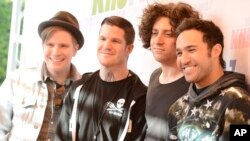From left to right, singer Patrick Stump, drummer Andy Hurley, musician Joe Trohman, and musician Pete Wentz of the rock band Fall Out Boy arrive at Wango Tango 2013 at The Home Depot Center on May 11, 2013 in Carson, Calif.