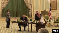 President Donald Trump and Saudi Arabian King Salman bin Abdulaziz sign nearly $110 billion in agreements Saturday to bolster the military capabilities of Saudi Arabia, in Riyadh, Saudi Arabia, May 20, 2017.