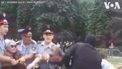 Kazakhstan: Người biểu tình chống chính phủ bị khiêng đi chỗ khác