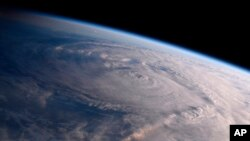 This photo made available by NASA shows Hurricane Harvey over Texas on Aug. 26, 2017, seen from the International Space Station.
