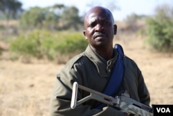 "Ranger Lawrence Baloi says his job has changed from focusing on conservation to security. ""You need your heart to do this,"" he says about his risky job. (Photo: Gillian Parker for VOA)"