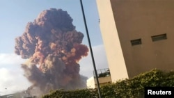 Smoke rises after an explosion in Beirut, Lebanon August 4, 2020, in this picture obtained from a social media video. Karim Sokhn/Instagram/Ksokhn + Thebikekitchenbeirut/via REUTERS