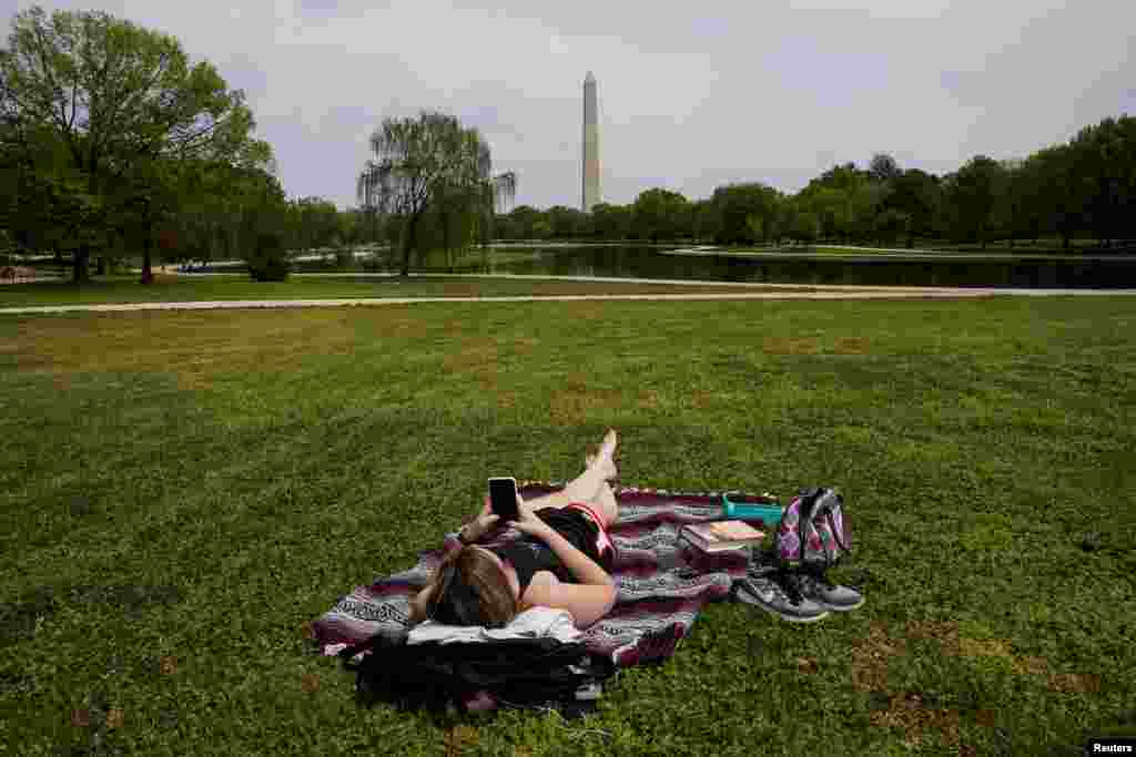 Chelsea Bruchs enjoys a nice day on the National Mall during the COVID-19 pandemic continues in Washington, D.C., April 29, 2020.