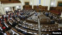 FILE - Lawmakers attend a parliament session in Kyiv, Ukraine, Dec. 21, 2017.