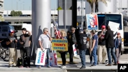 FILE - Supporters of President Donald Trump gather outside Tom Bradley International Terminal as protests against President Trump's executive order banning travel from seven Muslim-majority countries continue at Los Angeles International Airport Sunday, J