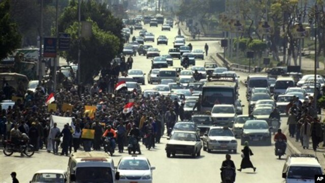 Anti-government protesters march in a street in Cairo, Egypt, Feb 11, 2011