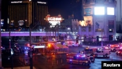 Las Vegas Metro Police and medical workers stage in the intersection of Tropicana Avenue and Las Vegas Boulevard South after a mass shooting at a music festival on the Las Vegas Strip in Las Vegas, Nevada, Oct. 1, 2017.