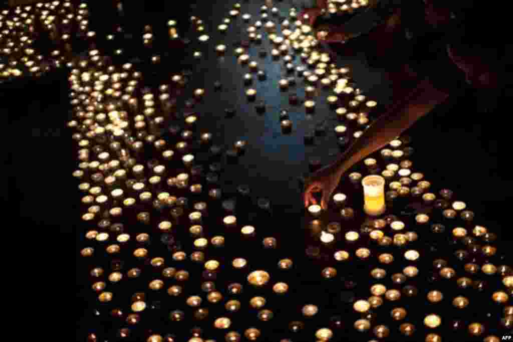 People light candles for the victims of Friday's bomb attack and shooting rampage at the Oslo Cathedral, Norway, Thursday, July 28, 2011. The Norwegian man who admitted killing 76 people in a bombing and youth camp massacre is a sociopath who acted withou