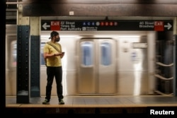 The $1 trillion bipartisan infrastructure plan passed by the US Senate in August, includes money to shore up public transportation like New York City's subway, May 3, 2021.