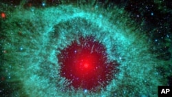 Dust makes this cosmic eye look red. This eerie Spitzer Space Telescope image shows infrared radiation from the well-studied Helix Nebula (NGC 7293) in the constellation Aquarius.