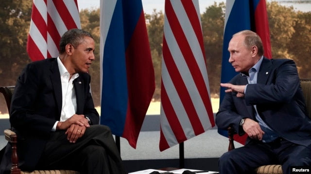 Presidents Barack Obama and Vladimir Putin met last June in Northern Ireland, but a planned summit next month is cancelled.