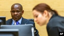 FILE - A defendant (L) awaits his appeals judgment at the International Criminal Court in The Hague, Netherlands, Feb. 27, 2015. Some in Africa see the court as a European neo-colonial institution.