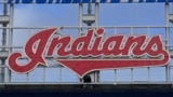 The Indians sign hangs at Progressive Field before the first baseball game of a doubleheader against the Chicago White Sox, Sept. 23, 2021, in Cleveland.