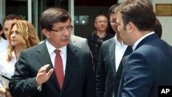 Menteri Luar Negeri Turki Ahmet Davutoglu di Ankara, (24/6).