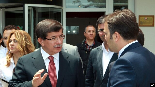 Turkish Foreign Minister Ahmet Davutoglu talking to an adviser, in Ankara, June 24, 2012, in this image made available by the Turkish Foreign Ministry.