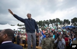 FILE - In this Saturday, Sept. 5, 2015 file photo, Rwanda's President Paul Kagame waves to the crowd before speaking at a baby gorilla naming ceremony in Kinigi, northern Rwanda.