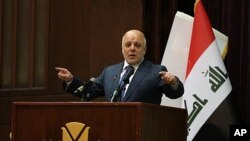 Thủ tướng Iraq Haider al-Abadi phát biểu trong cuộc họp báo loan báo chiến thắng cuộc chiến ba năm chống IS, ở Baghdad, Iraq, ngày 9 tháng 12, 2017.