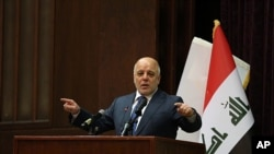 Iraq Prime Minister Haider al-Abadi gestures, during a press conference, in Baghdad, Iraq, Saturday, Dec. 9, 2017. Iraq said Saturday that its war on the so-called Islamic State is over after more than three years of combat operations drove the extremists from all of the territory they once held.