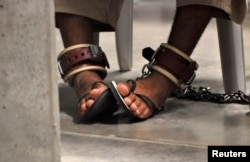 FILE - A detainee's feet are seen shackled to the floor inside the Camp 6 high-security detention facility at Guantanamo Bay U.S. Naval Base April 27, 2010.