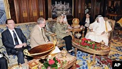 In this photo released by Saudi Press Agency, King Abdullah of Saudi Arabia, right, meets with Secretary of State Hillary Rodham Clinton, 3rd left, in Riyadh, Saudi Arabia, Friday, March 30, 2012.