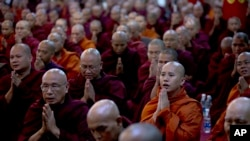 FILE - Controversial Buddhist monk Wirathu, second right foreground, who is accused of instigating sectarian violence between Buddhists and Muslims through his sermons.