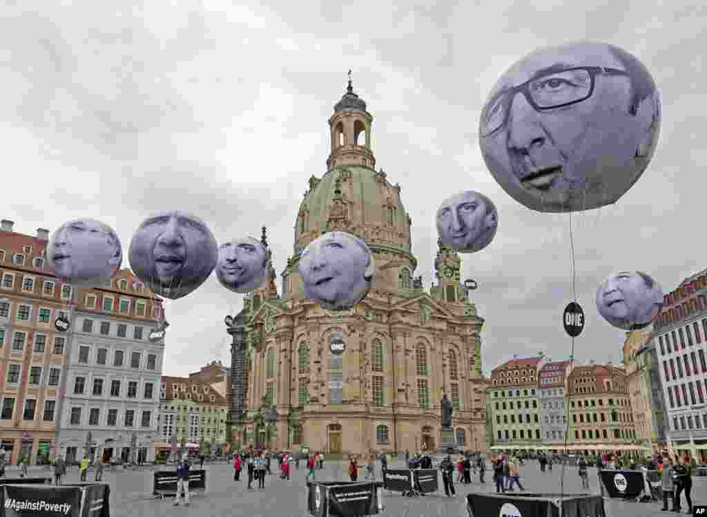 Activists of the international campaigning and advocacy organization ONE installed balloons with portraits of the G7 heads of state in front of the Frauenkirche cathedral (Church of Our Lady) prior to the G7 Finance Ministers meeting in Dresden, Germany.