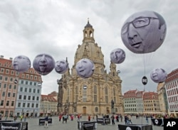 Activists of the international campaigning and advocacy organization ONE installed balloons with portraits of the G7 heads of state in front of the Frauenkirche cathedral (Church of Our Lady) prior to the G7 Finance Ministers meeting in Dresden, eastern G