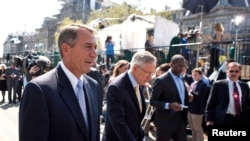 File - Speaker of the House John Boehner (L) and Senate Majority Leader Harry Reid
