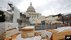 Building materials are stacked as construction continues on the inaugural platform in preparation for the swearing-in ceremonies for President-elect Donald Trump on the Capitol steps in Washington, Dec. 8, 2016. Trump will be sworn in as president on Jan.