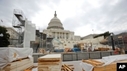 Building materials are stacked as construction continues on the inaugural platform in preparation for the swearing-in ceremonies for President-elect Donald Trump on the Capitol steps in Washington, Dec. 8, 2016. Trump will be sworn in as president on Jan. 20, 2017.