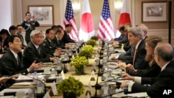 Japanese Foreign Minister Fumio Kishida, left, and Defense Minister Gen Nakatani, second from left, attend a meeting with U.S. Secretary of State John Kerry, third from right, and Secretary of Defense Ashton Carter, not visible, in New York, April 27, 2015.