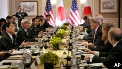 Japanese Foreign Minister Fumio Kishida, left, and Defense Minister Gen Nakatani, second from left, attend a meeting with U.S. Secretary of State John Kerry, third from right, and Secretary of Defense Ashton Carter, not visible, in New York, April 27, 201
