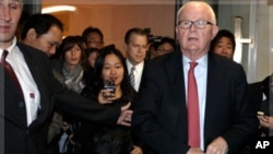 U.S. Special Envoy for North Korea Policy Stephen Bosworth (R) and U.S ambassador to the International Atomic Energy Agency Glyn Davies (L) leave their hotel for the United States Mission in Geneva, October 24, 2011.
