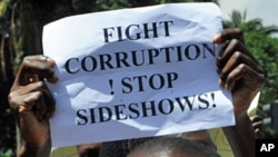 Kenyans demonstrate on 17 Feb 2010 to vent their anger at a coalition government falling apart over graft allegations and its inability to further pledged reforms