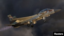FILE - An Israeli Air Force F-15 fighter jet flies during an aerial demonstration at a graduation ceremony for Israeli airforce pilots at the Hatzerim air base in southern Israel.