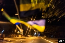 The Gabonese flag is reflected on the windscreen of a taxi before the deserted streets of the capital Libreville, Aug. 29, 2016.