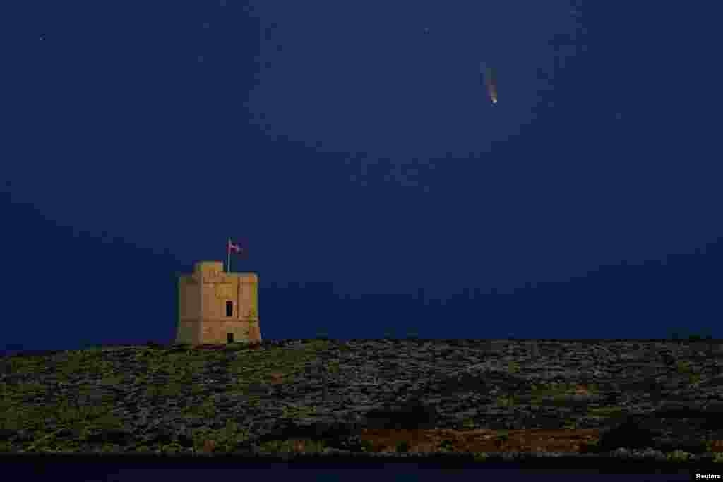 "The Comet C/2020 or ""Neowise"" is seen in the sky behind St. Mark's Tower, a 17th century coastal fortification near the village of Bahar ic-Caghaq, Malta."