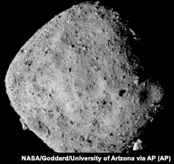 This mosaic image, created from 12 PolyCam images collected on December 2, 2018, and provided by NASA, shows the asteroid Bennu.