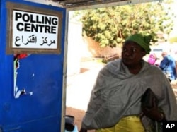 A South Sudanese woman arrives to vote at a polling centre in Khartoum January 9, 2011.