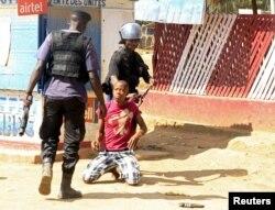 Policemen detain a protester during clashes in Lubumbashi, Democratic Republic of Congo, Nov. 10, 2015.