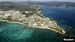 FILE - Coral reefs are seen along the coast near the U.S. Marine base Camp Schwab, off the tiny hamlet of Henoko in Nago on the southern Japanese island of Okinawa, October 29, 2015. Japan's government is supporting a candidate backed by the ruling party to win the mayoral election in the Okinawan city.