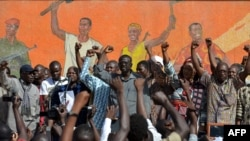 Opposition leaders gather during a protest at the Place de la Nation in Burkina Faso's capital Ouagadougou, calls for the departure of the military, Nov. 2, 2014.