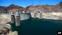FILE - The low level of the water line is shown on the banks of the Colorado River at the Hoover Dam in Hoover Dam, Arizona, May 31, 2018.