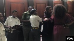 Marry Chiwenga with her relatives and prison guards at a Harare court.