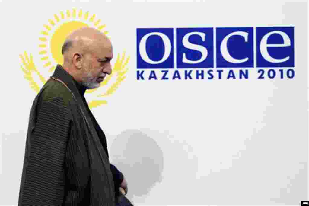 Afghan President Hamid Karzai arrives for the OSCE Summit at the Palace of Independence in Astana, Kazakhstan, Wednesday, Dec. 1, 2010. The OSCE Summit offers a unique opportunity to address urgent security challenges including transnational threats such