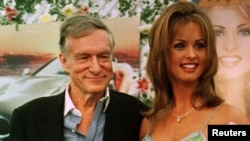 FILE - Karen McDougal, who had recently been named Playboy magazine's Playmate of the Year, poses with Playboy founder Hugh Hefner, May 28, 1998, during ceremonies at the Playboy Mansion in Beverly Hills, California.