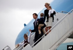 FILE - Arabella Kushner, her father, White House senior adviser Jared Kushner, carrying Joseph Kushner, and Ivanka Trump, carrying Theodore Kushner, step off Air Force One at the Palm Beach International Airport, in West Palm Beach, Florida, March 3, 2017. Ivanka Trump is wearing a skirt from her own collection. Despite efforts to address ethical concerns, Trump remains, for many, the living embodiment of the brand that bears her name.