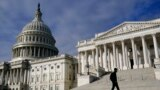 A man walks past the the U.S. Capitol, in Washington, Oct. 27, 2021.