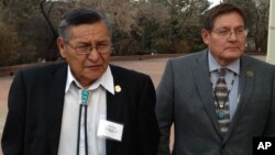 FILE - Ben Shelly, the President of the Navajo Nation, left, and Lorenzo Bates, Navajo Council Delegate walk outside the New Mexico Capitol in Santa Fe, New Mexico, Feb. 19, 2014.